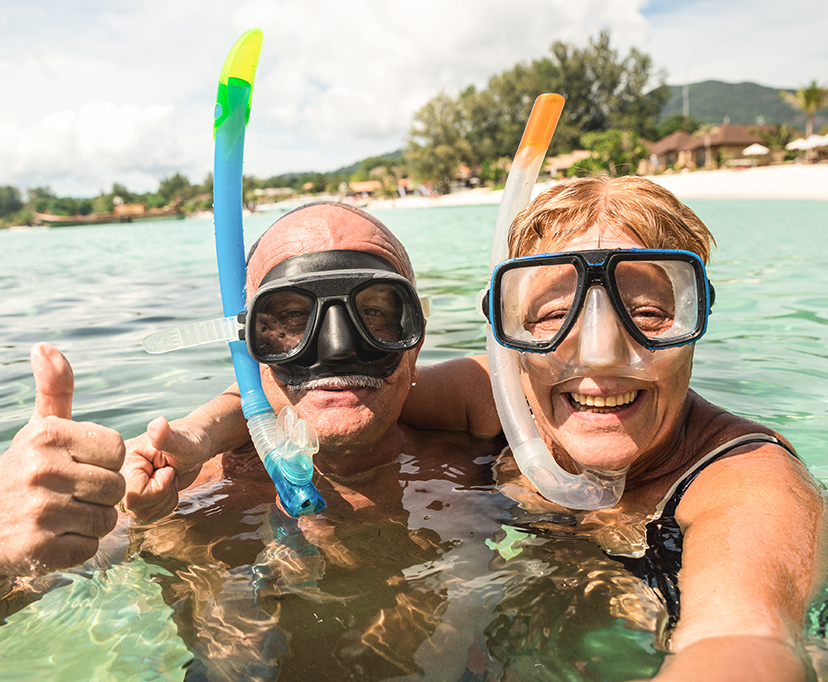 Older couple scuba diving